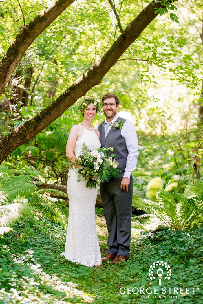 happy bride and groom in woods wedding photo