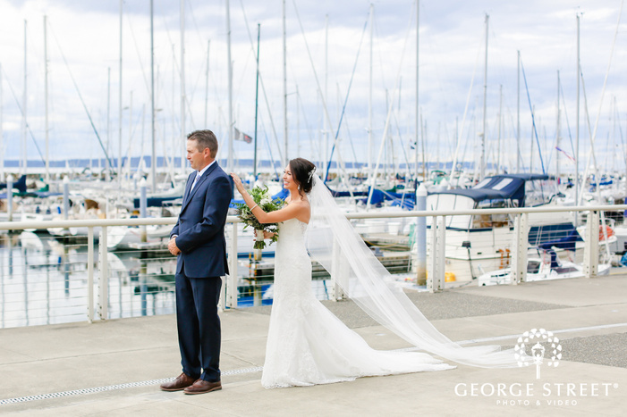 adorable bride and groom first sight on dock at ballard bay club in seattle