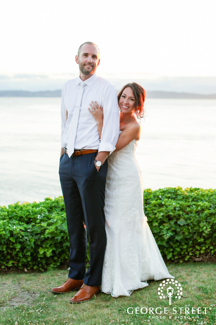 blissful bride and groom near lake wedding photography