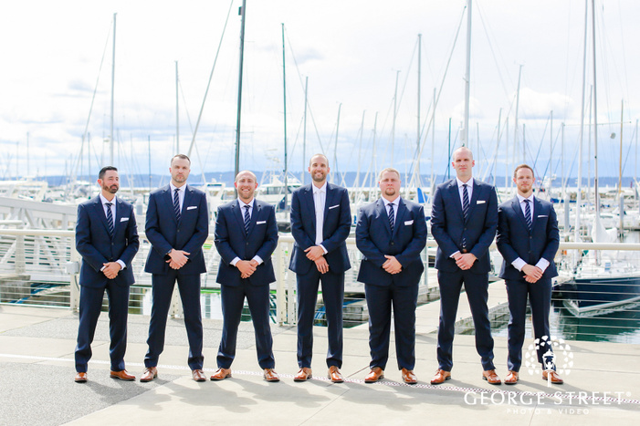 handsome groom and groomsmen at harbor wedding photography