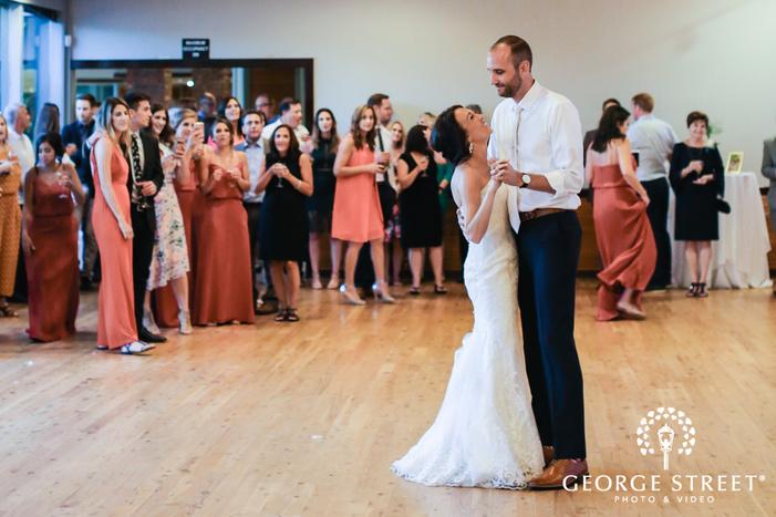 loving bride and groom first dance at ballard bay club in seattle