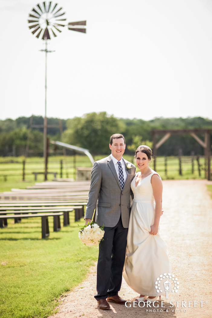 charming bride and groom on walkway of ranch austin wedding venue wedding photography