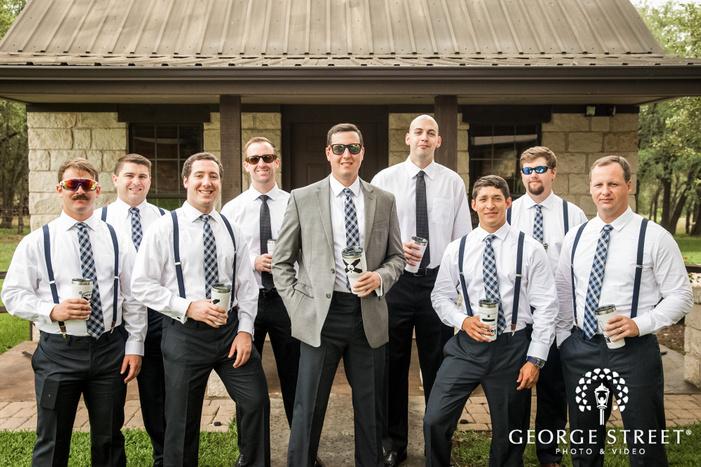 charming groom and groomsmen infront of varenda wedding photography