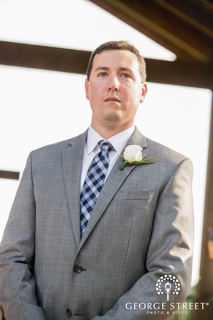 emotional groom first look at altar wedding photo