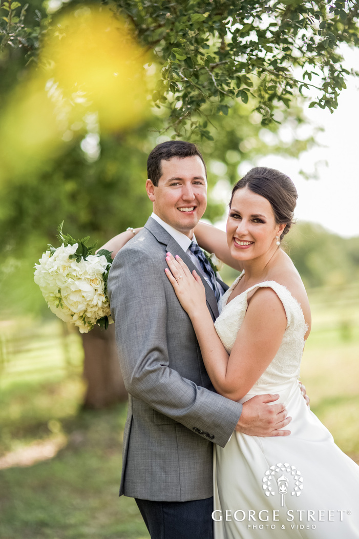 graceful bride and groom in green field wedding photo