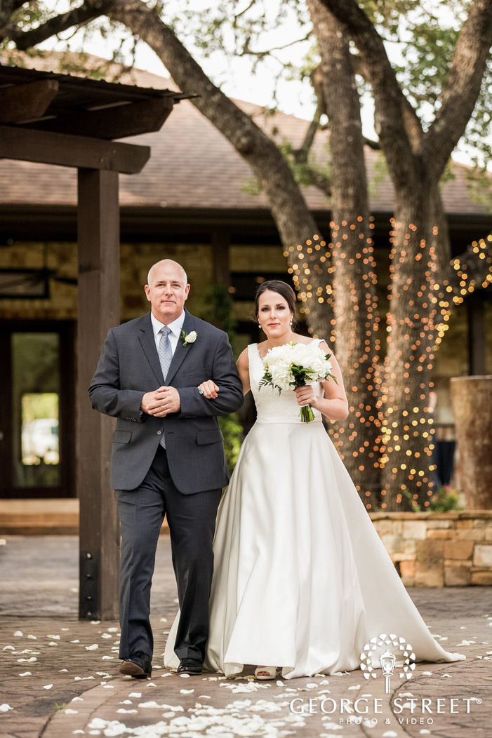 jovial bride and father walking down the aisle in austin wedding photo