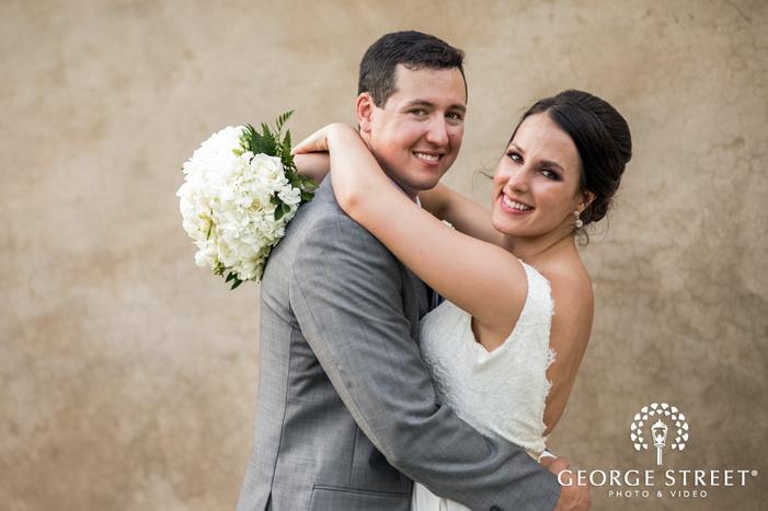 joyous bride and groom on pathway of reception venue wedding photos
