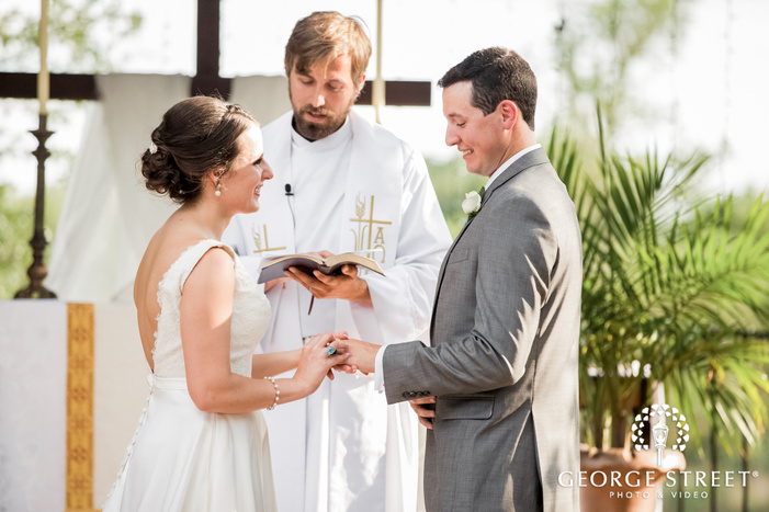 lovely bride and groom wedding ring exchange at altar wedding photo