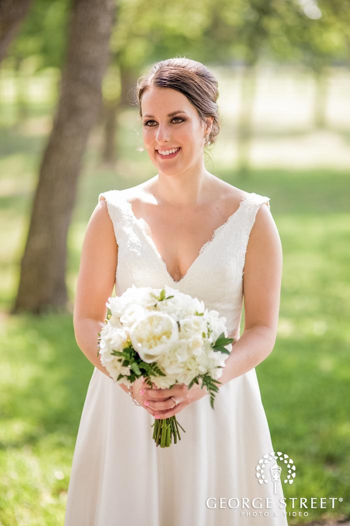 pretty bride in green lawn wedding photo