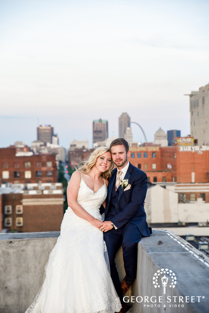 adorable bride and groom on rooftop at NEO on locust  LLC in st louis wedding photography