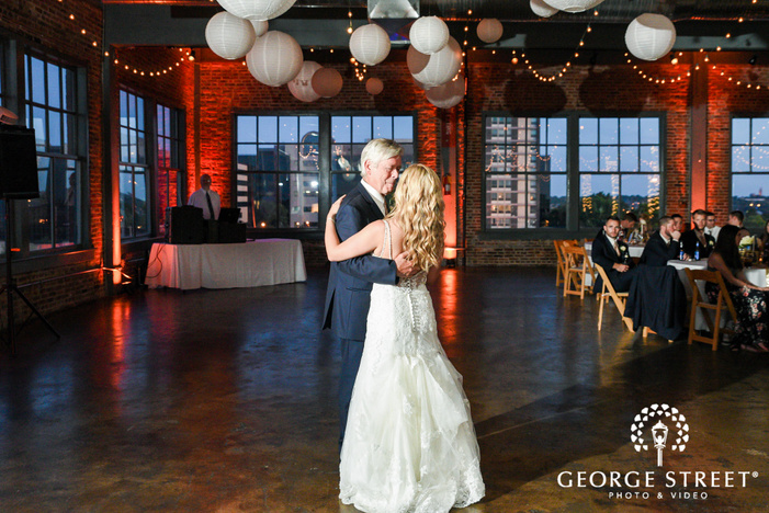 blissful bride and father dance in reception at NEO on locust  LLC