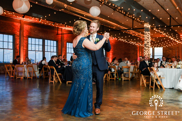 cheerful groom and mother dance at NEO on locust  LLC in st louis wedding photos