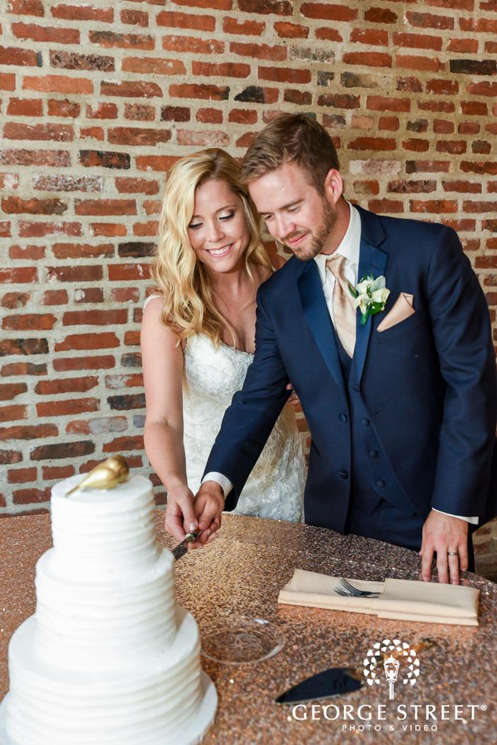 cute bride and groom cake cutting at NEO on locust  LLC