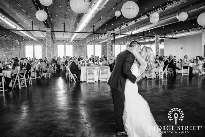 gorgeous bride and groom first dance in reception hall at NEO on locust  LLC in st louis