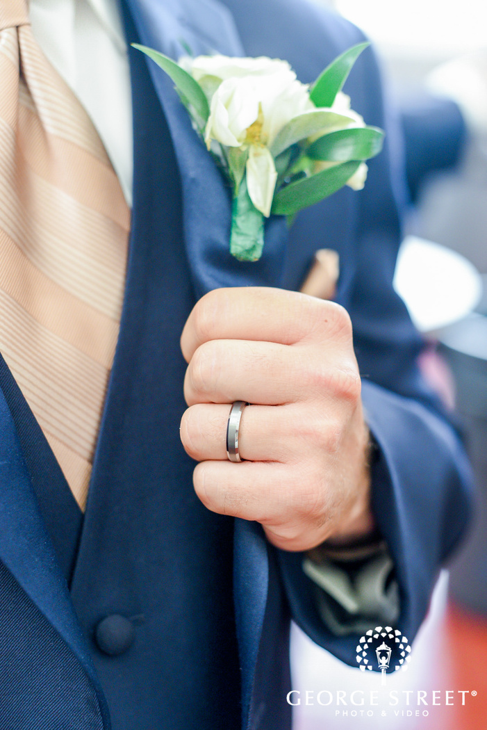 groom wedding ringt and boutonniere wedding photo