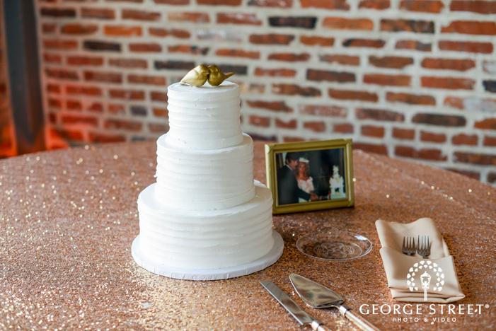 nice three tier cake with love birds topper wedding photo