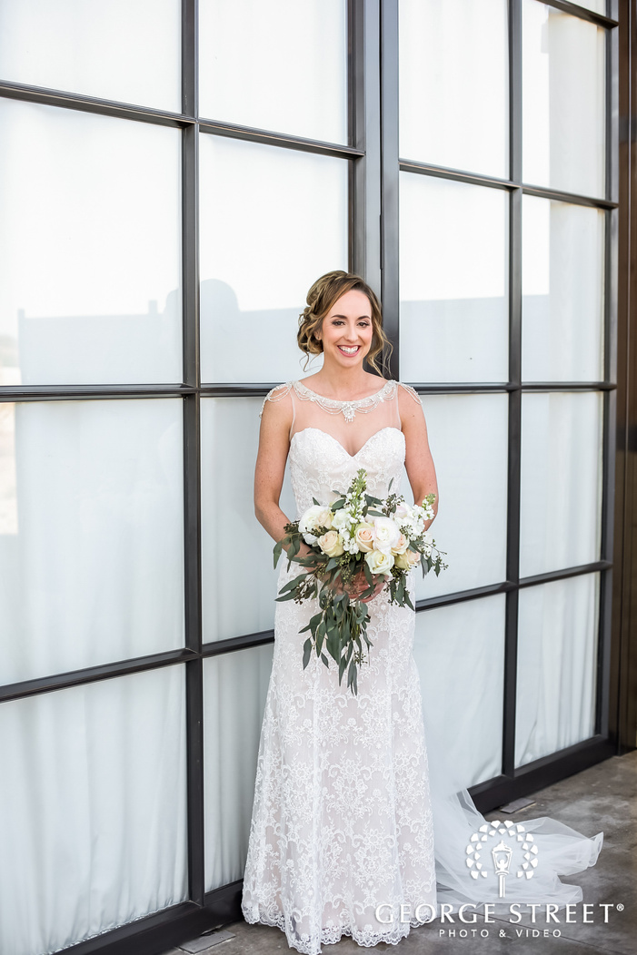 beautiful bride in front of window wedding photography