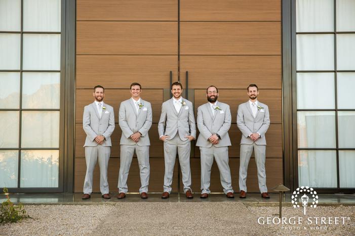 handsome groom and groomsmen at entrance door wedding photography