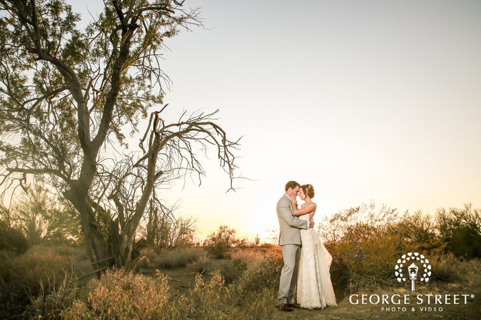 loving bride and groom in green field at the paseo in phoenix