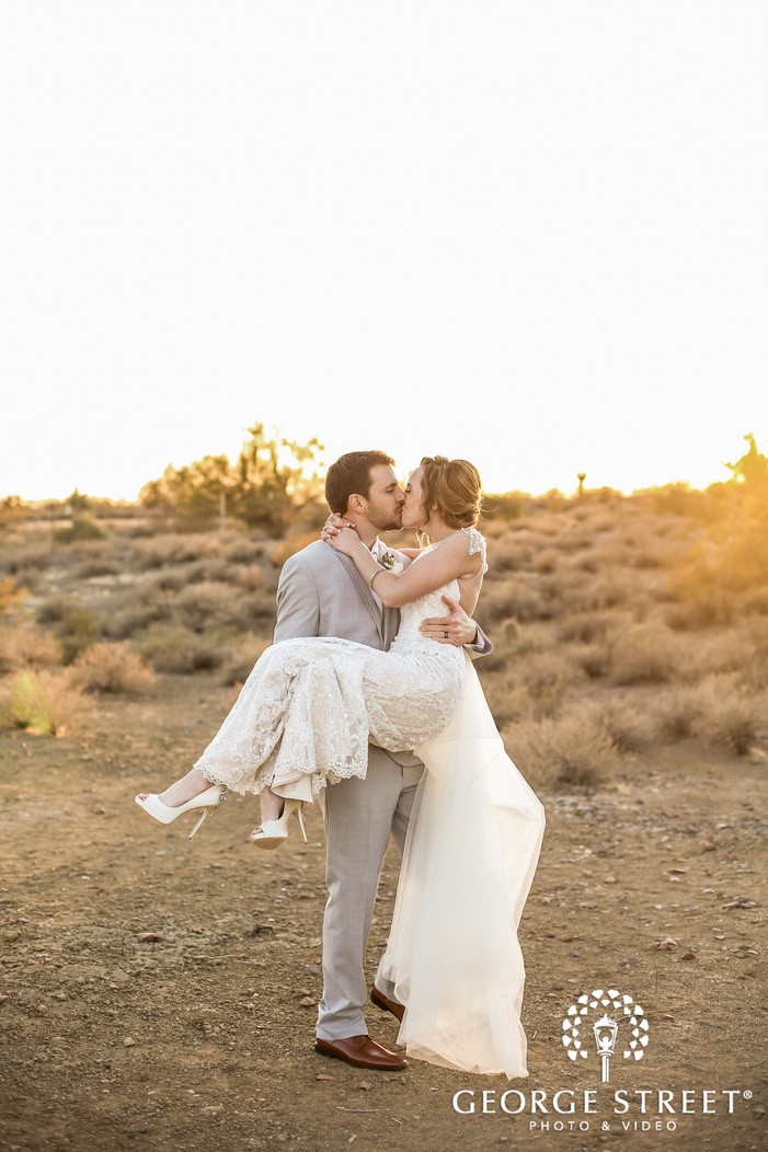 passionate bride and groom in barren field wedding photography