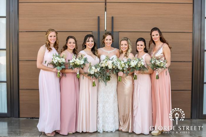 pretty bride and bridesmaids at entrance door wedding photography