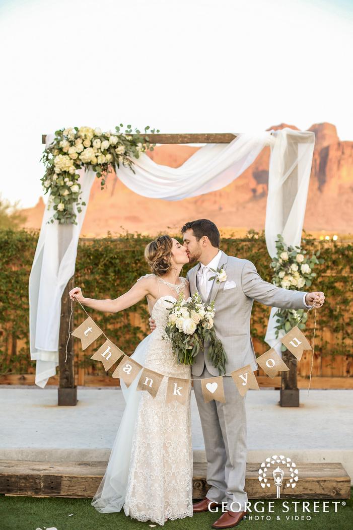 romantic bride and groom at wedding altar wedding photography