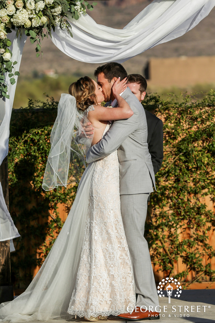 romantic bride and groom first kiss at the paseo in phoenix
