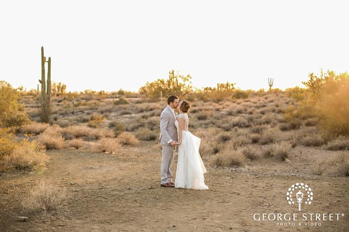 romantic bride and groom in barren field wedding photography