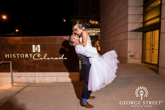 adorable bride and groom at entrance board wedding photography