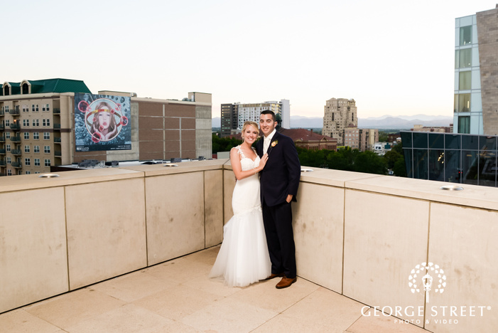 charming bride and groom on terrace of history colorado center in denver