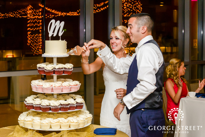 cheerful bride and groom cake cutting wedding photo