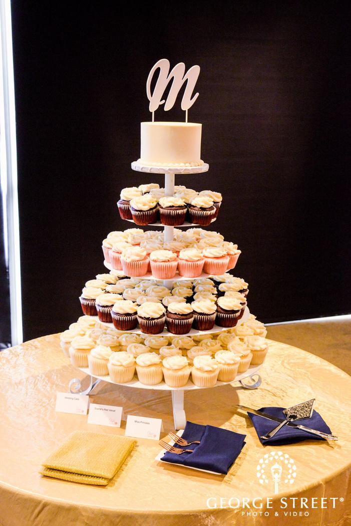 delightful reception wedding cake and cupcakes wedding photo