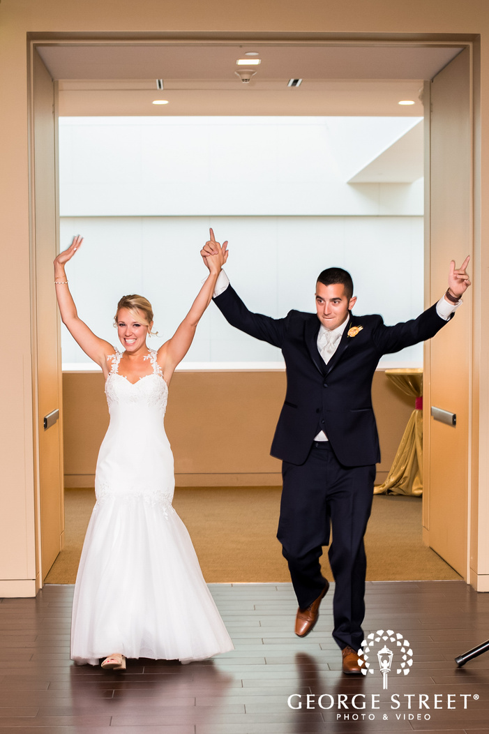 excited bride and groom reception entrance wedding photo