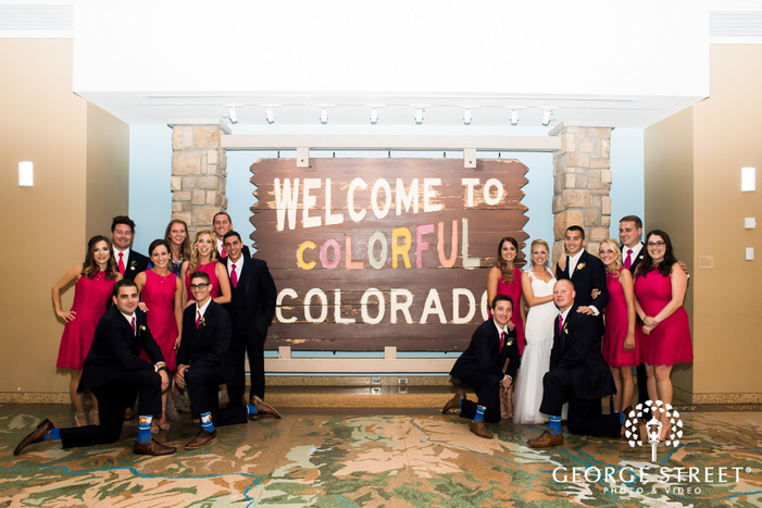 happy group with artistic board in lobby wedding photography