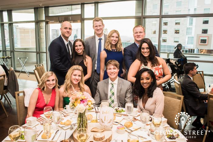 happy guests on reception table wedding photos