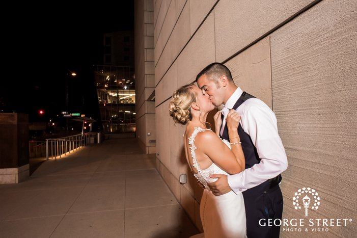 loving bride and groom in front of wall wedding photography