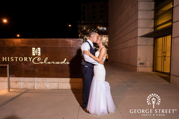 romantic bride and groom at the entrance of history colorado center in denver