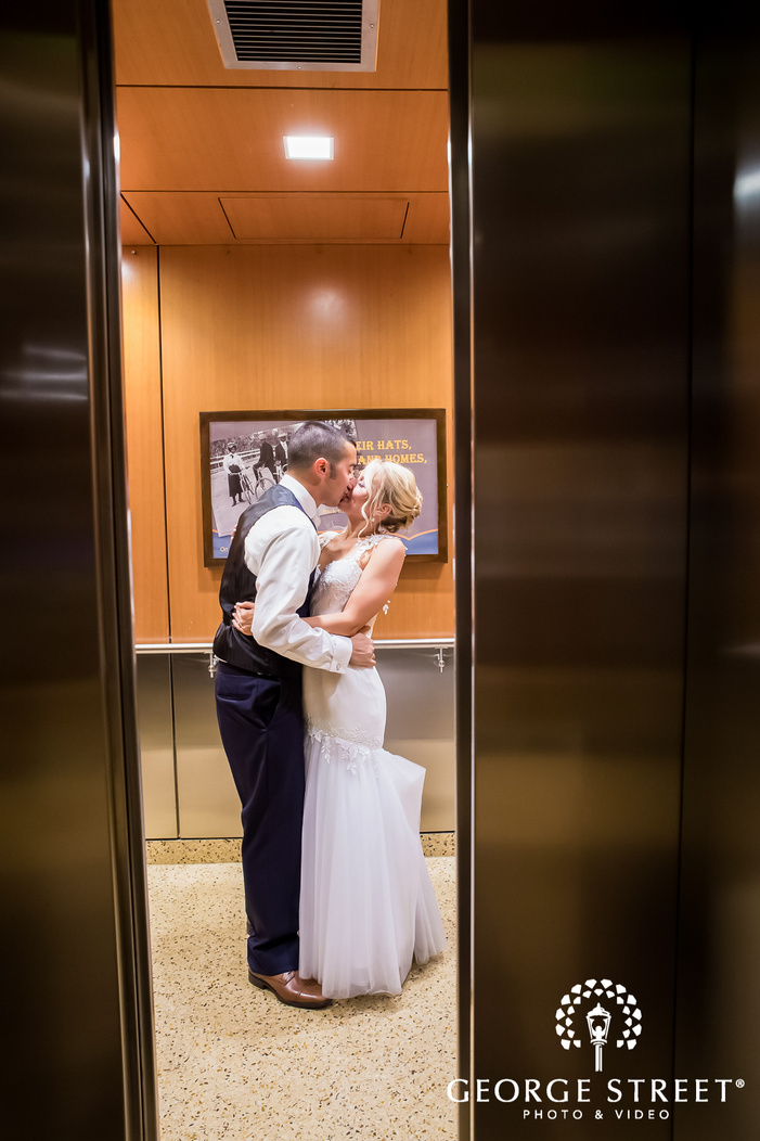 romantic bride and groom near elevator wedding photography