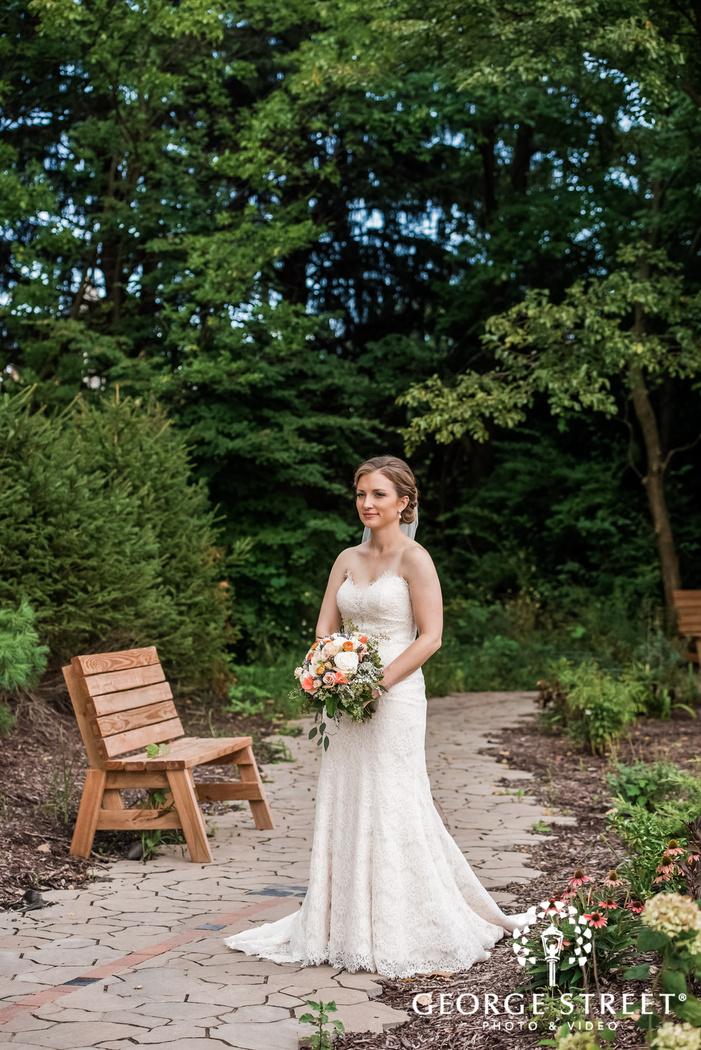 adorable bride posing on walkway