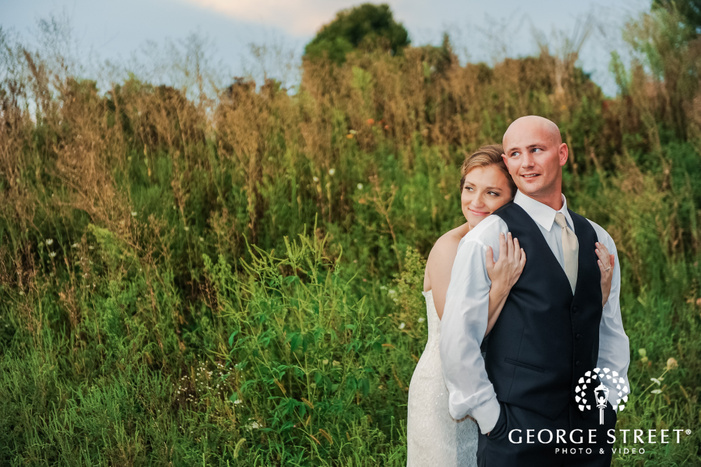 charming bride and groom in yard