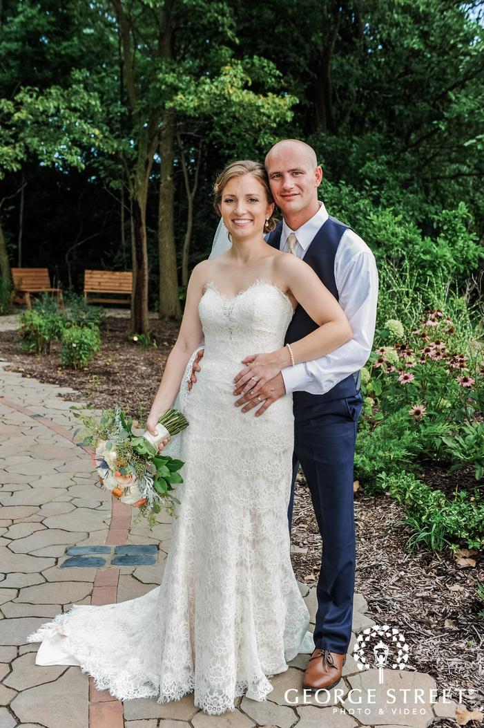 cute bride and groom on walkway wedding photography