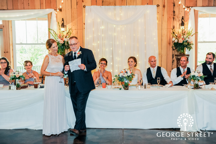 excited bride and groom during reception toast