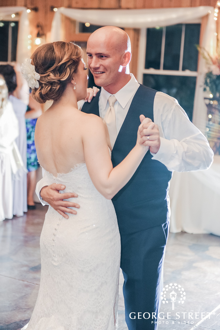excited bride and groom reception dance