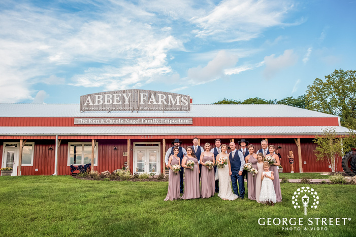 joyful couple with bridesmaids and groomsmen at abbey farms in chicago