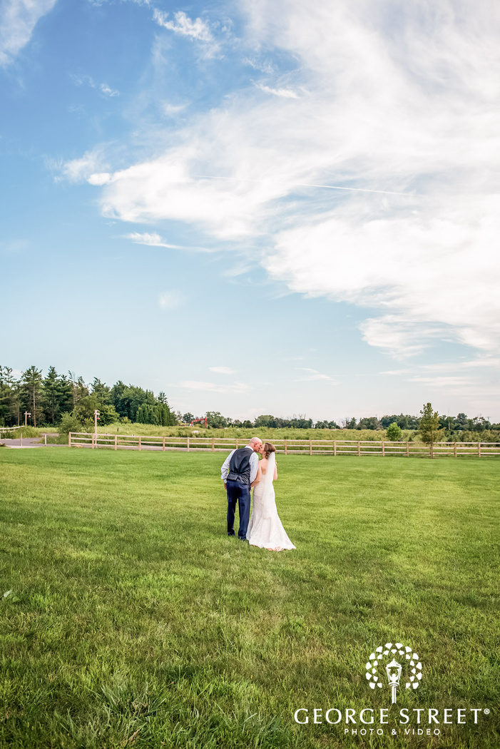 loving bride and groom in lawn wedding photos