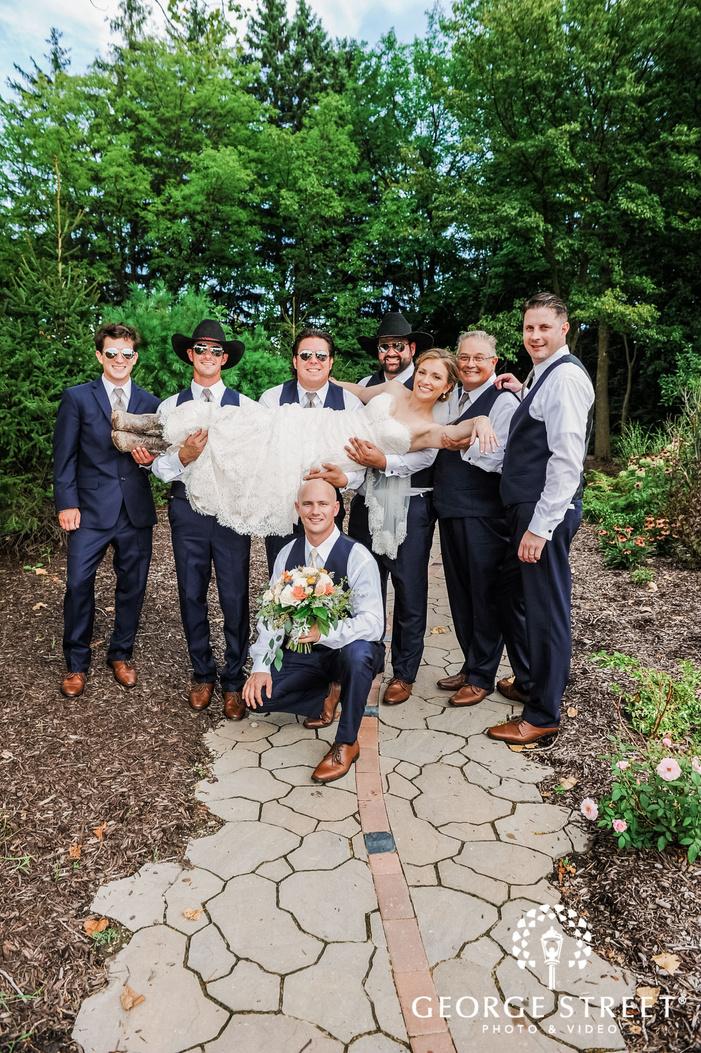 ravishing bride and groomsmen on walkway