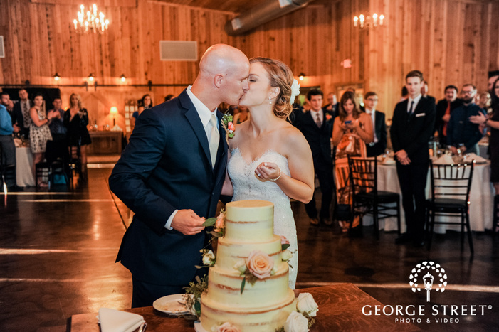 romantic bride and groom cake cutting ceremony at abbey farms in chicago