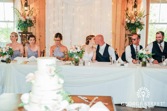 romantic bride and groom during reception toast at abbey farms in chicago