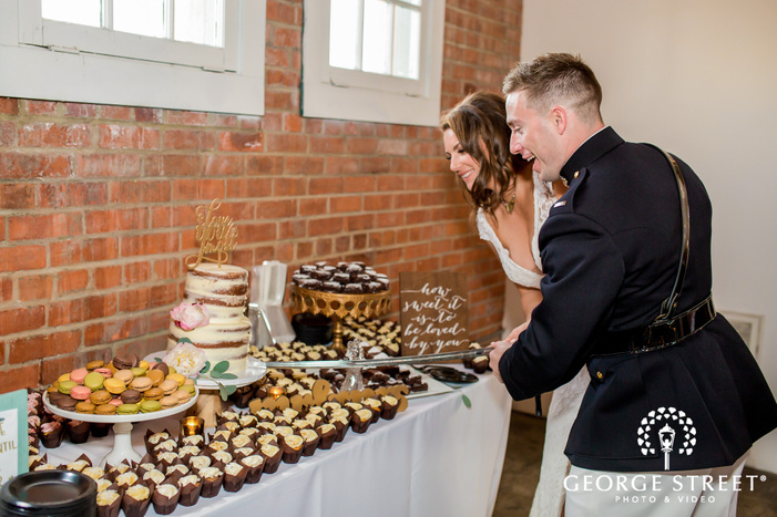 cheery bride and groom cake cutting ceremony wedding photography