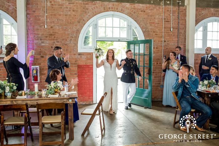 cheery bride and groom reception entrance at brick in san diego